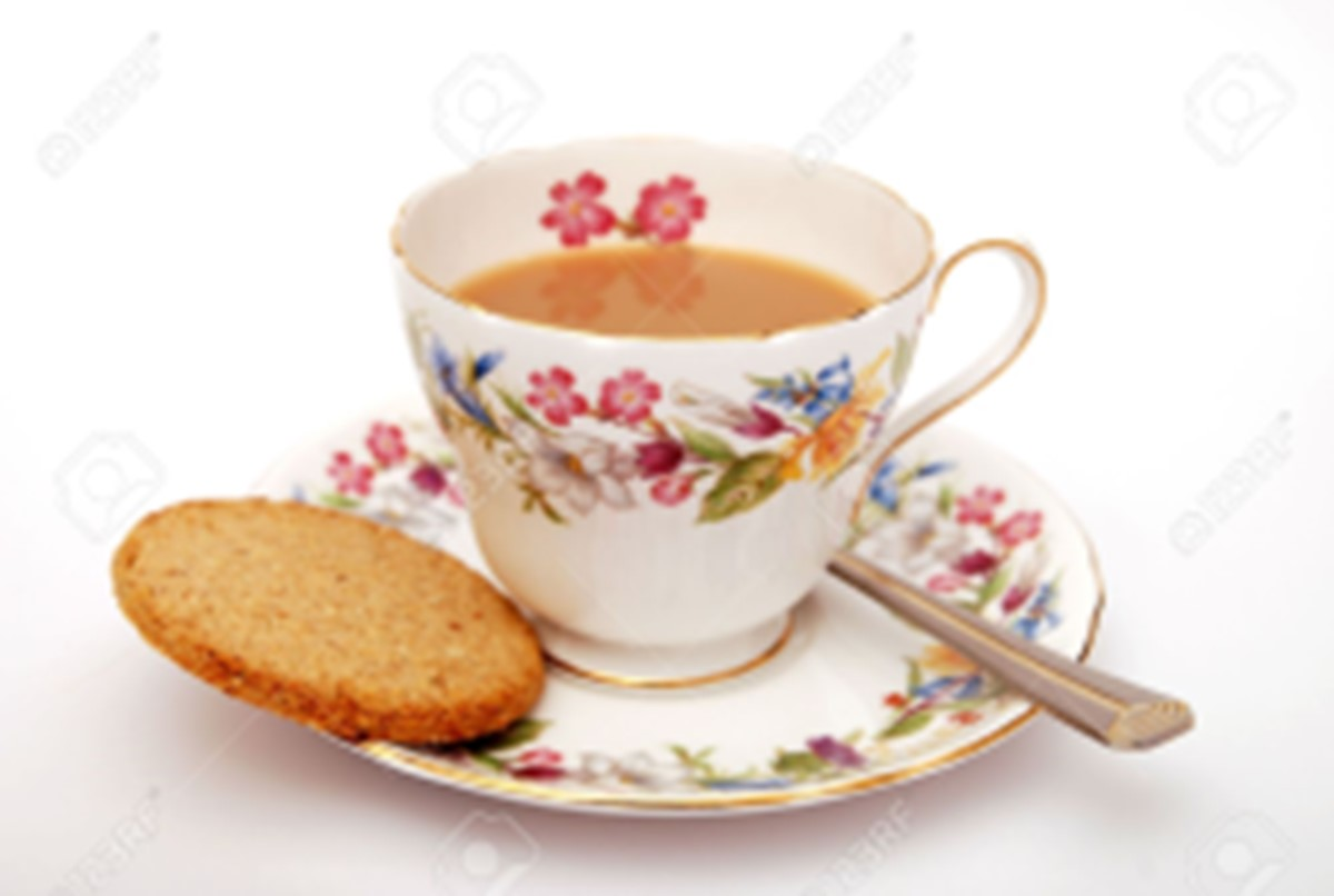2813103-cup-of-traditional-english-tea-with-biscuit-on-white-background.png